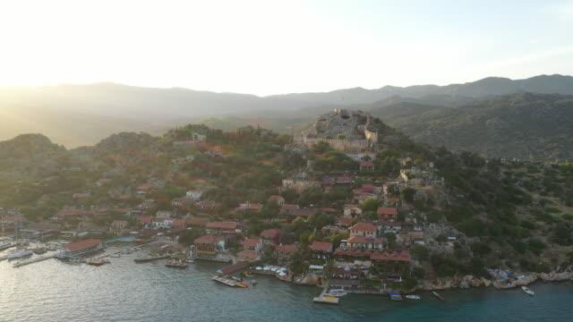 view of simena castle in kekova island / antalya, turkey - castle island stock videos & royalty-free footage