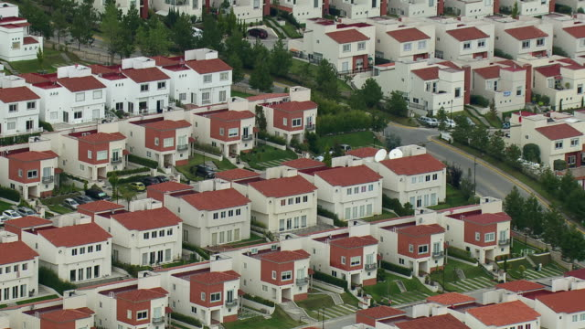 View of similar town homes lined up in a complex in Mexico City.