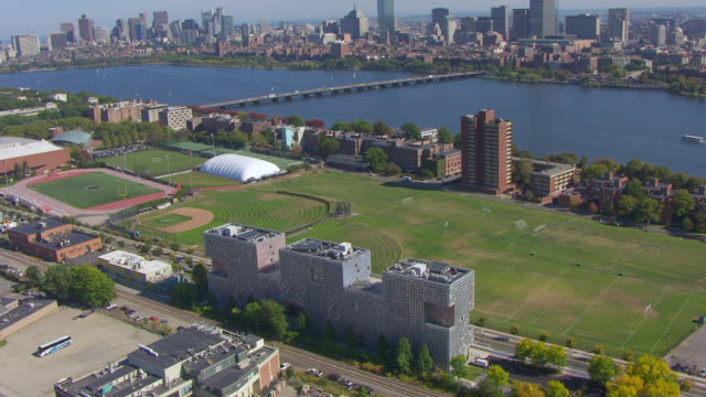 ws aerial pov view of simmons hall and charles river with cityscape / cambridge, massachusetts, united states - river charles stock videos & royalty-free footage