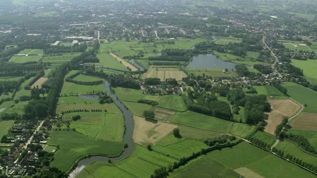 stockvideo's en b-roll-footage met ws aerial zi view of sinaai town / flanders, belgium - belgië