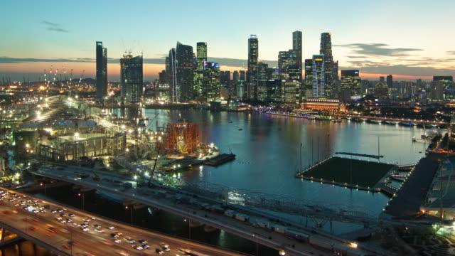 WS TD T/L View of Singapore's skyline at dusk /  Singapore, Singapore City.