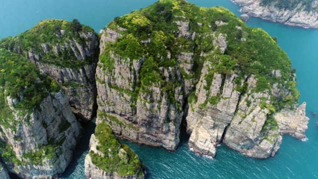 view of sinseondae cliff on the haegeumgang sea in geoje - rock formation stock videos & royalty-free footage