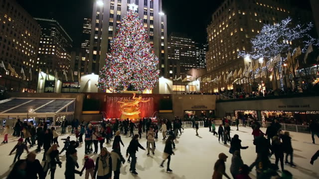 ws tu view of skaters and illuminated christmas tree at rockefeller center at night / new york, united states  - rockefeller center stock videos and b-roll footage
