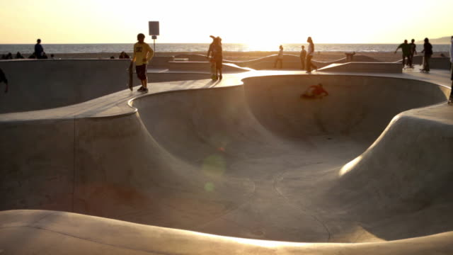 WS View of skaters at Venice Skateboard Park / Venice, California, USA