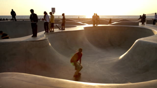 ws view of skaters at venice skateboard park / venice, california, usa - skateboard park stock videos & royalty-free footage
