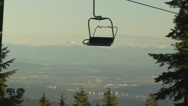 WS View of ski lift with Vancouver city in background / Vancouver, British Columbia, Canada