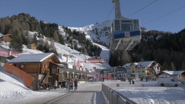 View of skiers and cable car at Pecol on sunny day in winter, Province of Trento,Trentino-Alto Adige/Sudtirol, Italy, Europe