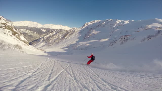 pov view of skiing on snow covered mountains. - snowboarding stock videos and b-roll footage