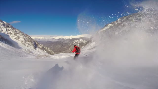 pov view of skiing on snow covered mountains. - スノーボード点の映像素材/bロール