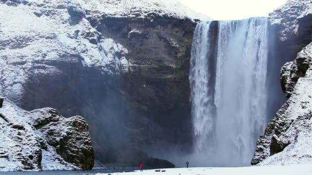 ws view of skogafoss waterfall / skogar, iceland - peter snow stock videos & royalty-free footage