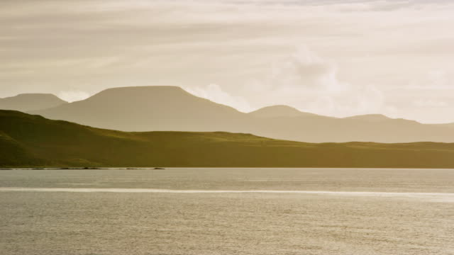 ws view of skye island mountains near dunvegan head with sun and clouds / skye island, scotland, united kingdom - 2k resolution stock videos and b-roll footage