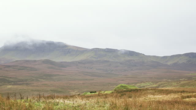 ws pan view of skye island mountains with overcast weather / skye island, scotland, united kingdom - 2k resolution stock videos and b-roll footage