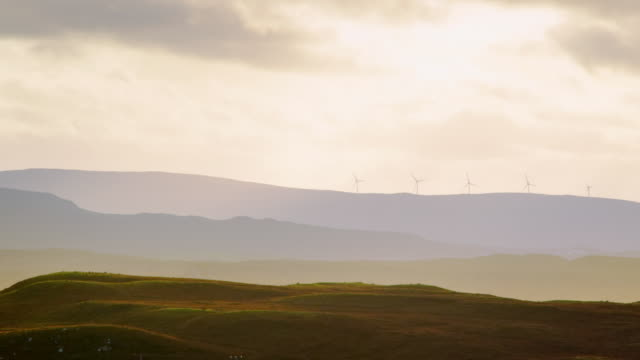 ws pan view of skye island wind turbines with sun rays and clouds / skye island, scotland, united kingdom - 2k resolution stock videos and b-roll footage