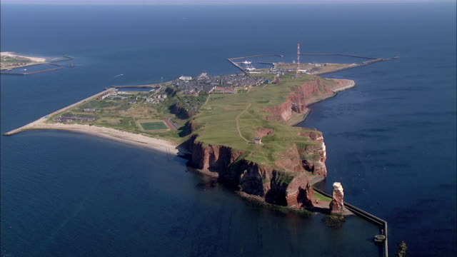 aerial ws zi view of skyline and island surrounded by ocean / heligoland, schleswig-holstein, germany - helgoland stock videos & royalty-free footage