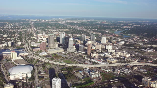 ws aerial pov view of skyline in downtown / tampa, florida, united states - tampa stock videos & royalty-free footage