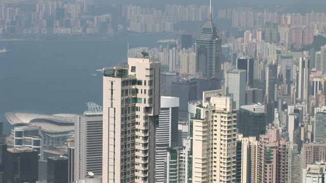 view of skyline in hong kong china - central plaza hong kong stock-videos und b-roll-filmmaterial
