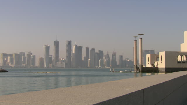 ws pan view of skyline of city / doha, qatar - doha stock videos & royalty-free footage