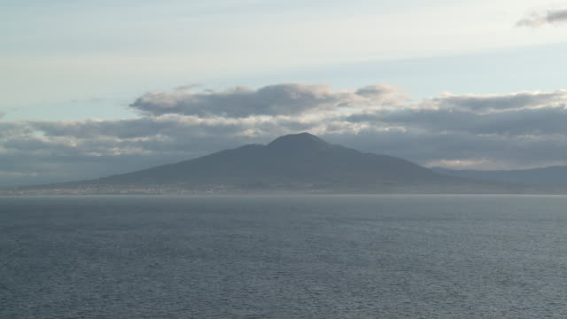 ws t/l view of skyline on ocean and boats moving in front of mount vesuvius / sorrento, campania, italy - italy stock videos & royalty-free footage