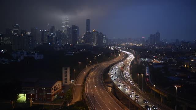 ws view of skyline with traffic moving on bridge / kuala lumpur, malaysia - kuala lumpur stock videos & royalty-free footage