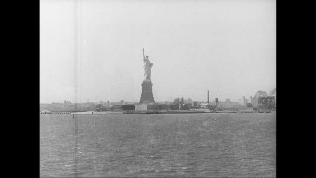 ws pov view of skyscraper and statue of liberty / new york city, new york state, united states - statue of liberty stock videos and b-roll footage