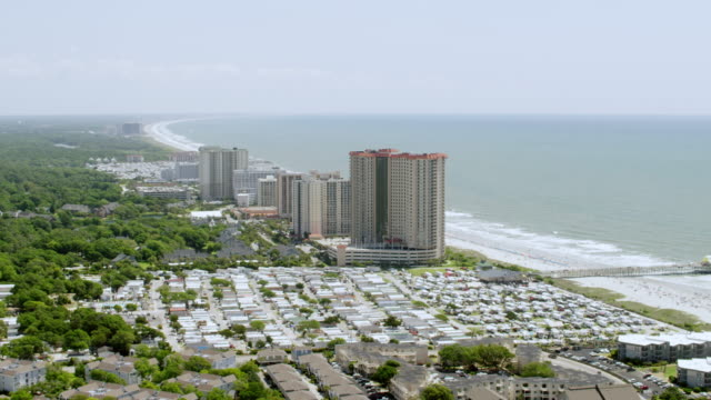 ws aerial pov view of skyscraper buildings and sea / myrtle beach, south carolina, united states - carolina beach stock videos & royalty-free footage