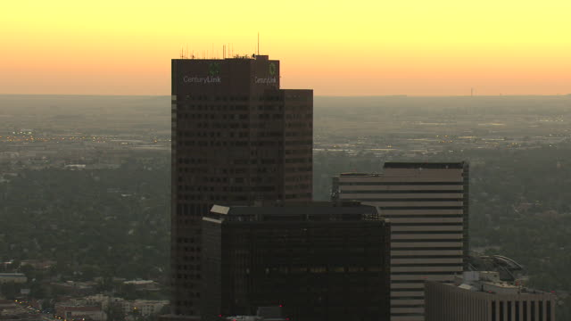 MS AERIAL View of skyscraper buildings downtown with pink hues during sunset / Denver, Colorado, United States