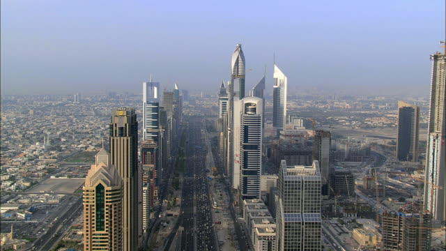AERIAL view of skyscrapers and Sheikh Zayed Road, Dubai, United Arab Emirates