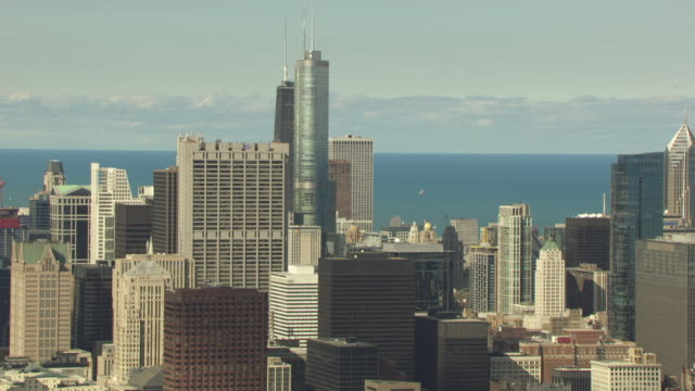 ws aerial pov view of skyscrapers in downtown, lake michigan in background / chicago, illinois, united states  - two prudential plaza stock videos & royalty-free footage
