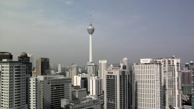 ws view of skyscrapers with kl tower / kuala lumpur, malaysia - menara kuala lumpur tower stock videos & royalty-free footage