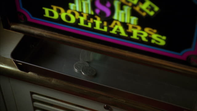 cu view of sliver dollar coins dropping into slot machine tray in las vegas casino / las vegas, nevada, usa - luck stock videos & royalty-free footage