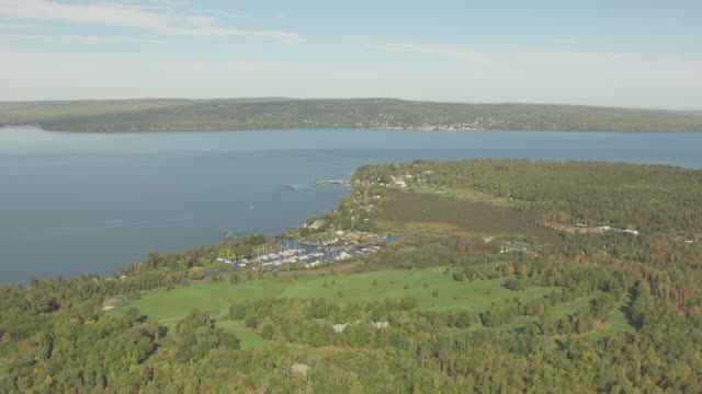 ws aerial view of small boat harbor on madeline island with lake superior / wisconsin, united states  - lago superiore video stock e b–roll