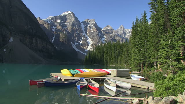 ms view of small boat harbour at moraine lake in ten peaks valley at nationalpark / lake louise, alberta, canada - valley of the ten peaks stock videos and b-roll footage