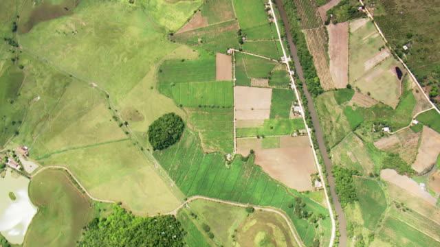 WS AERIAL View of Small farms on edge of Parque Nacional da Serra dos Orgao / Rio de Janeiro, Brazil