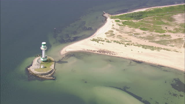 aerial ms view of small lighthouse / kiel canal, schleswig-holstein, germany - schleswig holstein stock-videos und b-roll-filmmaterial