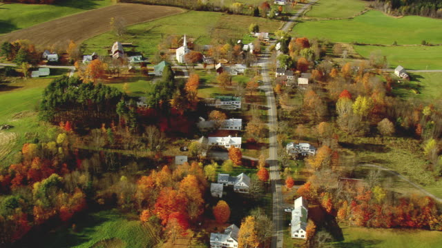 ms aerial zi pan view of small peacham town surrounded by autumn color tree / vermont, united states - vermont stock videos & royalty-free footage