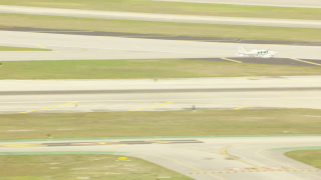 ws aerial ts view of small plane taking off from palm beach airport / palm beach, florida, united states - small stock videos & royalty-free footage