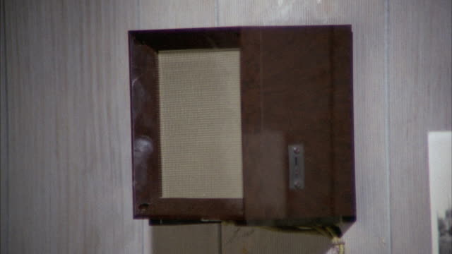 ms view of small square wood intercommunication speaker on wall / los angeles, california, united states - intercom stock videos and b-roll footage