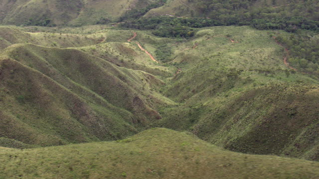 ws aerial view of small valley/ minas gerais, brazil - minas stock videos and b-roll footage
