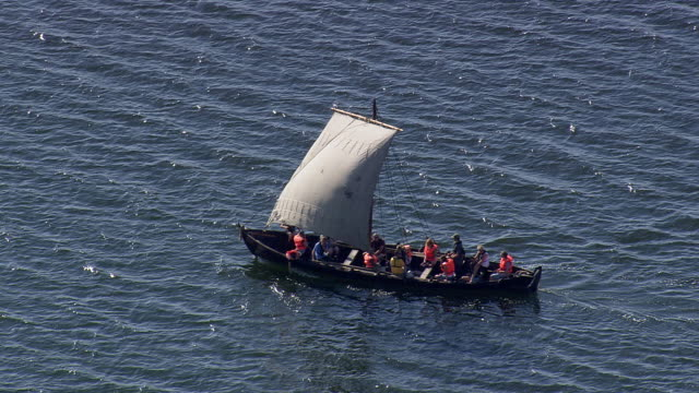 ws aerial zo view of small viking boat near roskilde / sjaelland, denmark - viking stock videos and b-roll footage