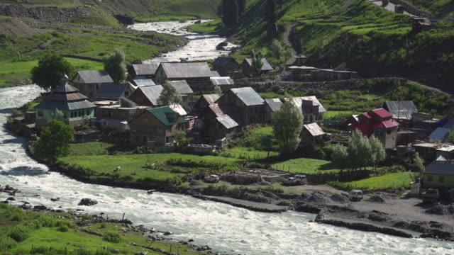 view of small village near the river - village stock videos & royalty-free footage