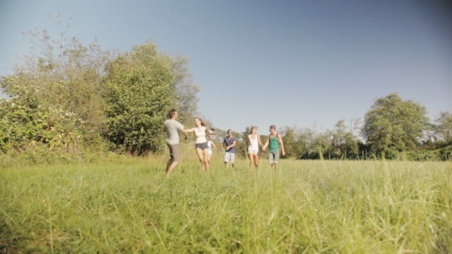 WS View of smiling friends walking together in countryside / Langley, British Columbia, Canada