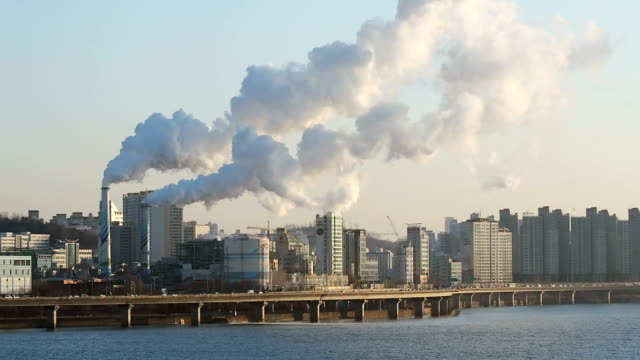 ws view of smog from coal fired power station along gangbyeonbungno express way bridge / seoul, south korea - smog video stock e b–roll