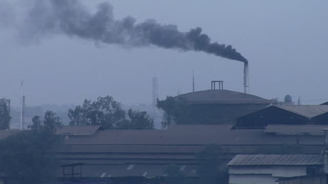 WS View of smoke coming out of chimney, Kanakaria textile mills / Ahemdabad, Gujarat, India