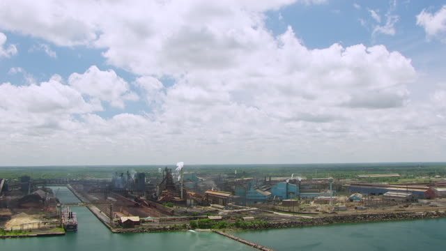 WS AERIAL POV View of smoke rising into USS Steel Gary Works steel mill building / Lake County, Gary, Indiana, United States