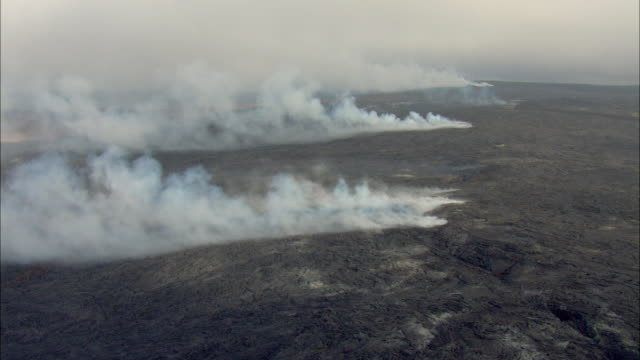 ws pov aerial view of smoky volcanic landscape / hawaii, usa - meteorology stock videos & royalty-free footage