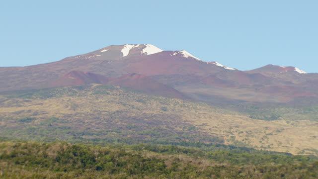 ws aerial view of snow capped mauna kea volcano on big island / hawaii, united states - hawaii islands stock videos & royalty-free footage
