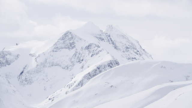 view of snow capped mountains on a misty winter day - traditionally norwegian stock videos & royalty-free footage