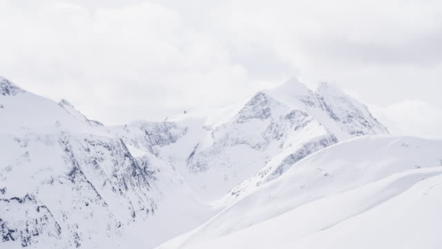 view of snow capped mountains - avalanche stock videos and b-roll footage