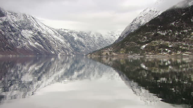 ws pan view of snow covered fjord in norway / norway - norway stock videos & royalty-free footage