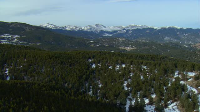 WS POV AERIAL View of snow covered hills near Pike National Forest outside Denver / Denver, Colorado, USA